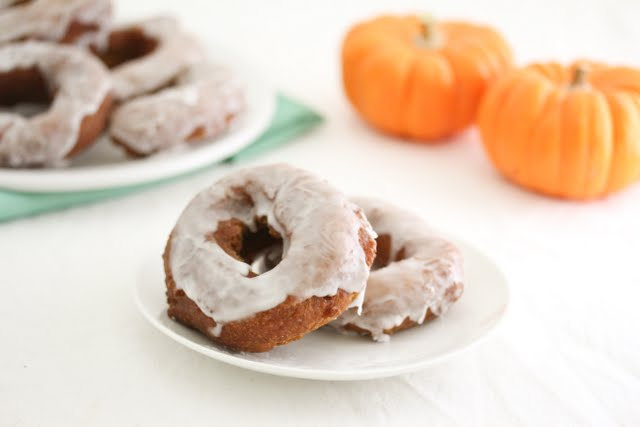 photo of two donuts on a plate