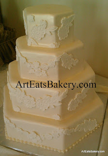Four tier hexagon chamagne pearl fondant custom wedding cake with elegant romantic flower lace design