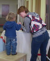 Oliver Gentzsch Bult (age 2) learns about irons from his mom, Velma Gentzsch