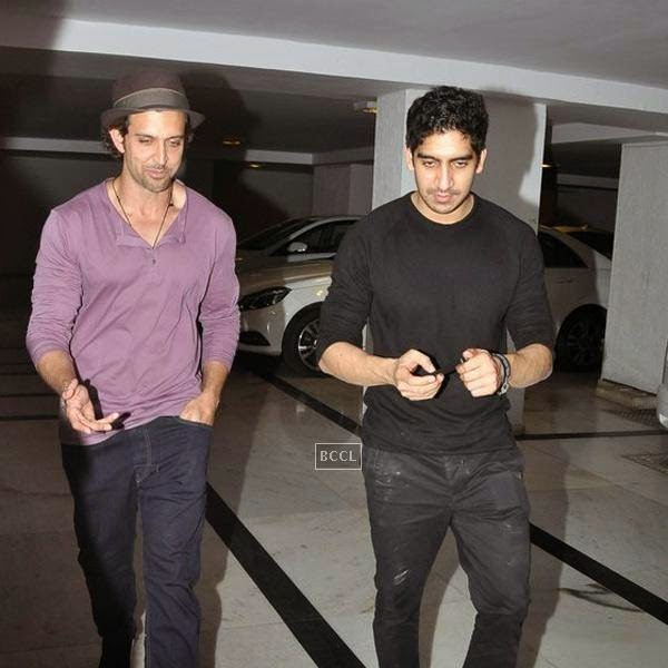 Hrithik Roshan and Ayan Mukerji leave after attending Karan Johar's party, organised at his residence, on July 26, 2014.(Pic: Viral Bhayani)