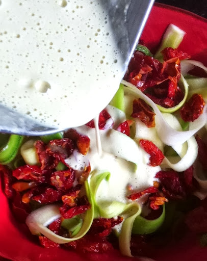 Raw Zucchini Fettuccine and Sun Dried Tomatoes in Cashew Sour Cream Sauce