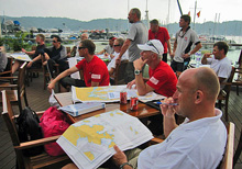 J/80 police sailors- navigating for sailing regatta in Hong Kong