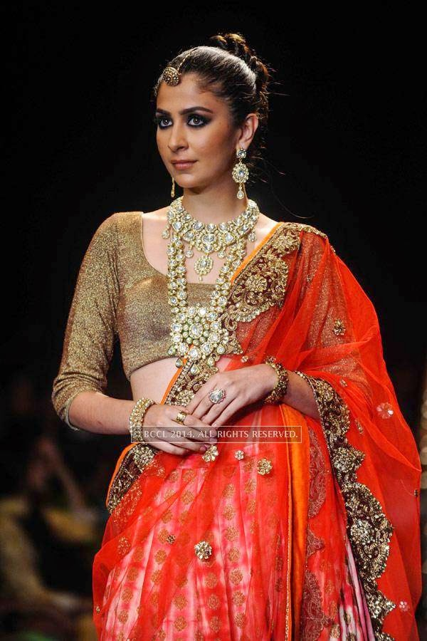 A model displays a creation by Golecha Jewels on Day 3 of India International Jewellery Week (IIJW), 2014, held at Grand Hyatt, in Mumbai.<br /> <br /> <br /> <br /> <br /> <br />