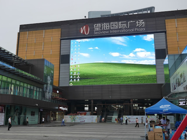 giant screen in front of the Seaview International Plaza displaying a Windows OS desktop