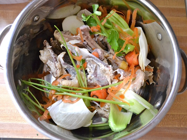 veggies scraps and chicken pieces and check bones in pot