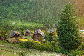 The Last Light on Traditional Wooden hutts of Taobat Valley Azad Kashmir Pakistan.