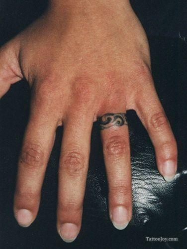 Ring finger  tattoo