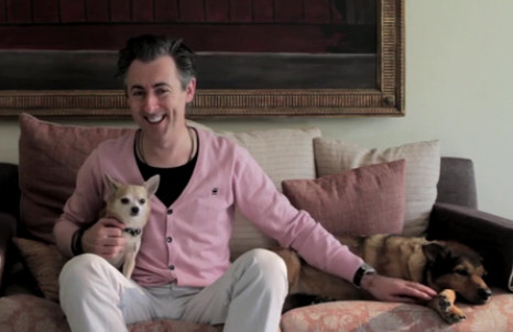 Alan Cumming and two dogs inside