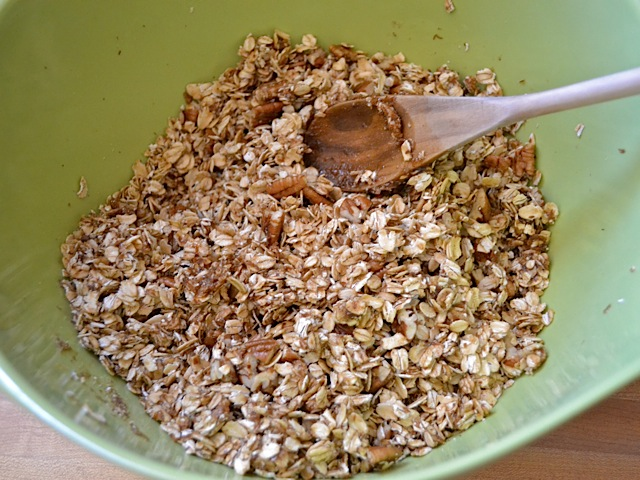 oats and sugar mixture stirred together with wooden spoon
