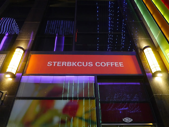 "Vacant store at Kaifu Wanda Plaza in Changsha with ""Sterbkcus Coffee"" sign"