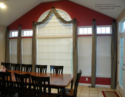 Operable Bottom-up Spring Roller Shade with an Arched Top. Made with one of Romanzia's Sheerweave Sunscreening Fabrics.  Photograph courtesy of Connie Turski Interiors.