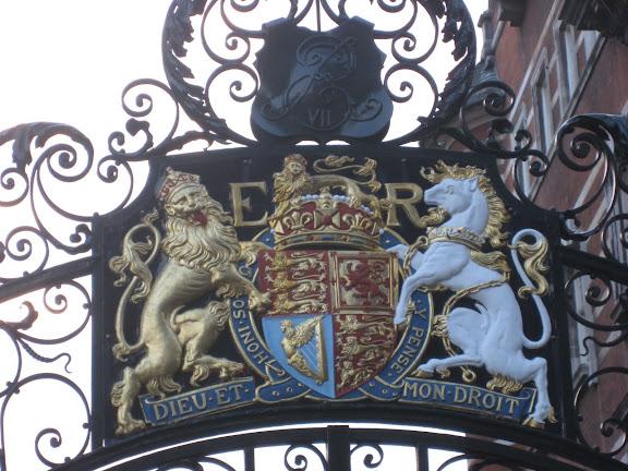 British crest on iron gates