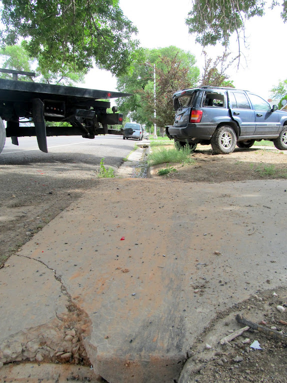 Skidmark where the Jeep hopped the driveway
