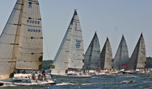 J/111 one-design sailboats- sailing off start