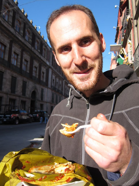 Jack eating one of the best tamales ever on the street of Mexico City