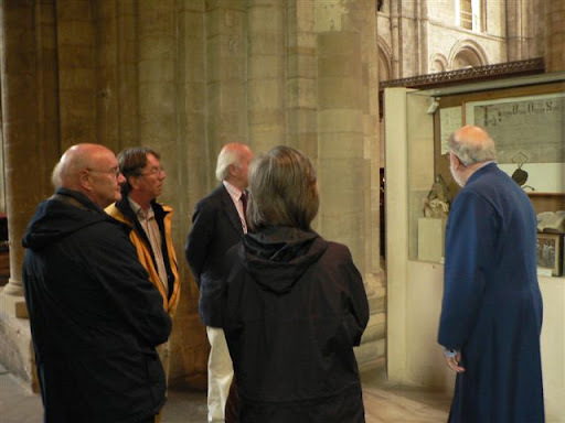 People being given a guided tour of Romsey Abbey