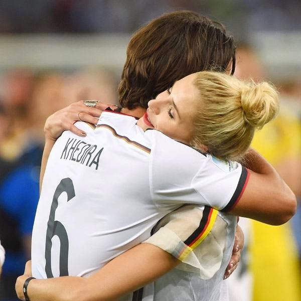 Germany's midfielder Sami Khedira celebrates with his wife after winning the 2014 FIFA World Cup final football match between Germany and Argentina 1-0 following extra-time at the Maracana Stadium in Rio de Janeiro, Brazil, on July 13, 2014.