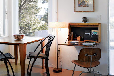 on the inside of one of the cottages of wellfleet at cape cod is another beautiful example of a practical but stylish desk from the new york times style