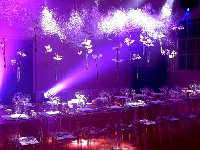 Table in violet light at a molecular gastronomy dinner at Somerset House on the Strand in London England