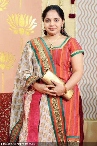 Singer Saindhavi strikes a pose for shutterbugs as she attends the wedding of Sudha Raghunathan's son Kaushik with Urmitapa, held in the city recently.