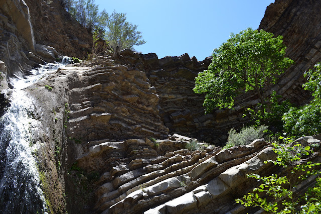 upward looking at the curve of rock the falls comes down through