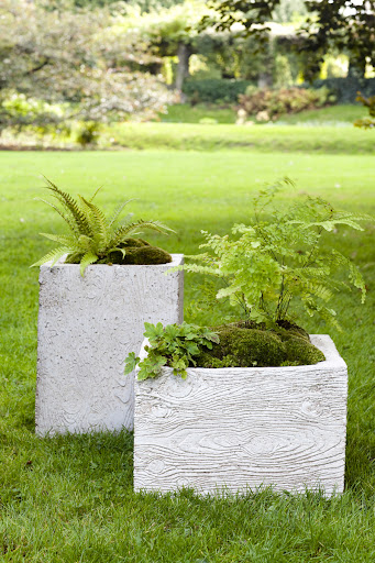 Two finished faux bois planters - the same mold is used for both containers.