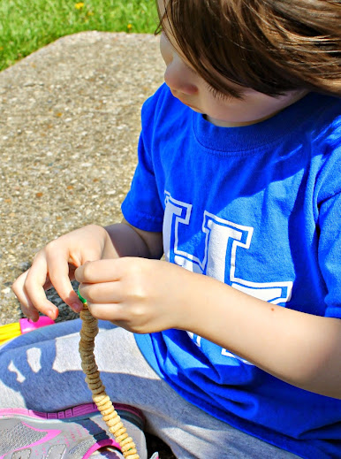 Slide circular cereal over a pipe cleaner - easy for kids and good for motor skills practice!