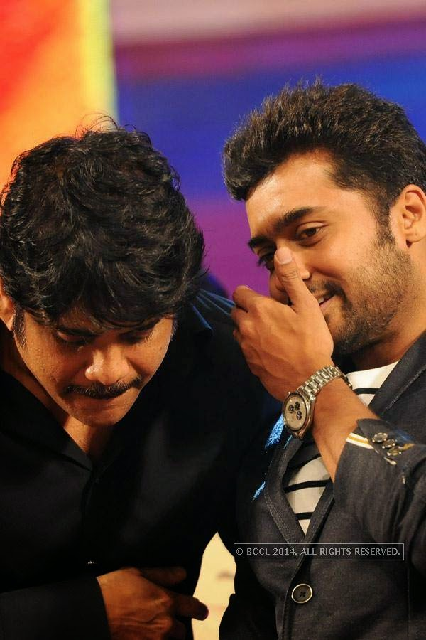 Nagarjuna and Suriya during the audio launch of latters film in Hyderabad.
