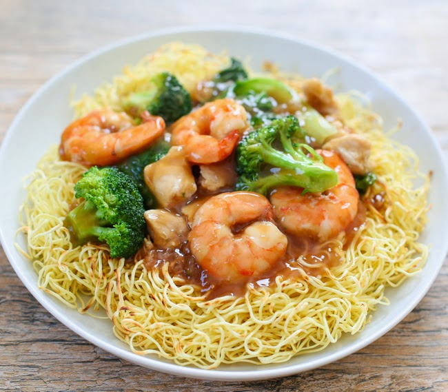 crispy pan-fried noodles with shrimp and broccoli in a savory sauce