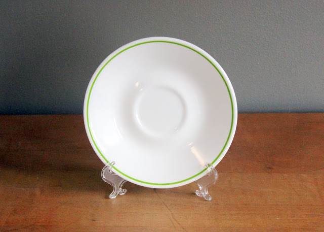 Corelle lime green-rimmed china saucers available for rent from www.momentarilyyours.com, $0.750 each.