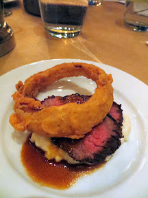 Fifth course, Beautiful serving of Irving St Kitchen Teres Major Steak with garlic grits, ancho ketchup, onion rings, marrow sauce paired with 2010 Hawks View Washington Cabernet Sauvignon
