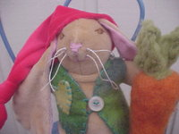 Christmas Bunny, slightly weighted, with Needle Felted Carrot