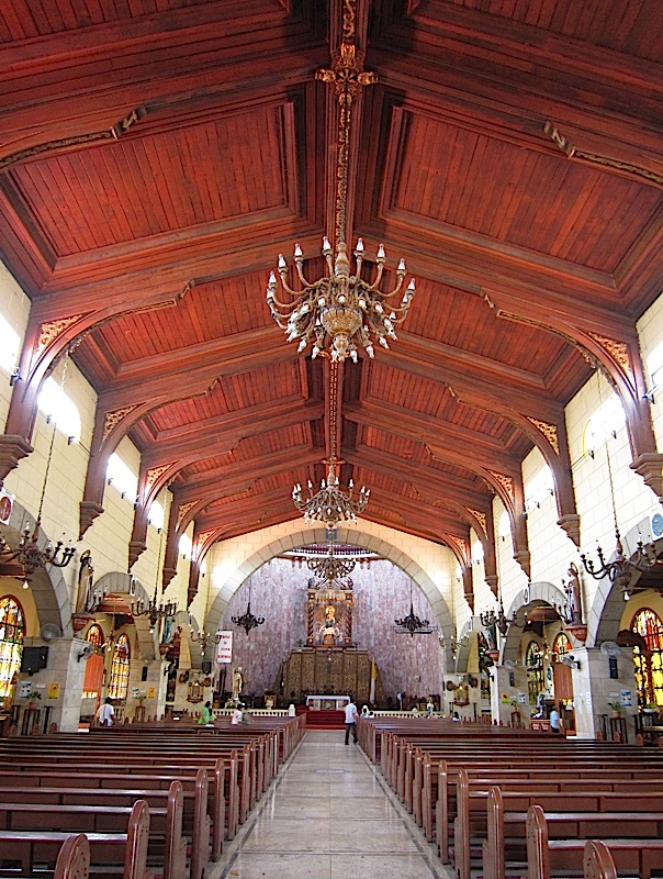 nave, altar and wooden ceiling of the Agoo Basilica