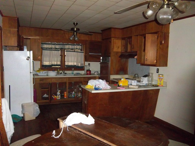 Outdated kitchen in investment property for sale as-is by investor.