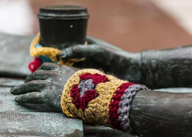Knitting around statue
