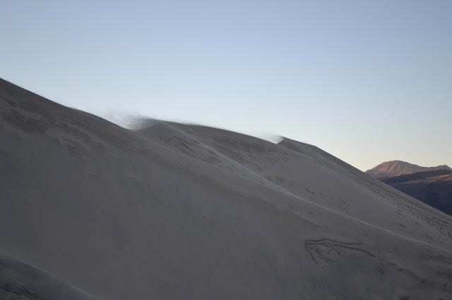 sand blowing of peaks and twisting light