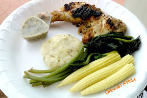 Parmesan grilled chicken with boiled corn, spinach salad and mashed potatoes.