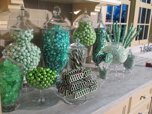 Glorious display of green candies in pretty vessels in the kitchen.