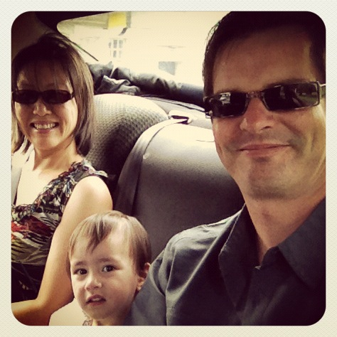 smiling family in a taxi