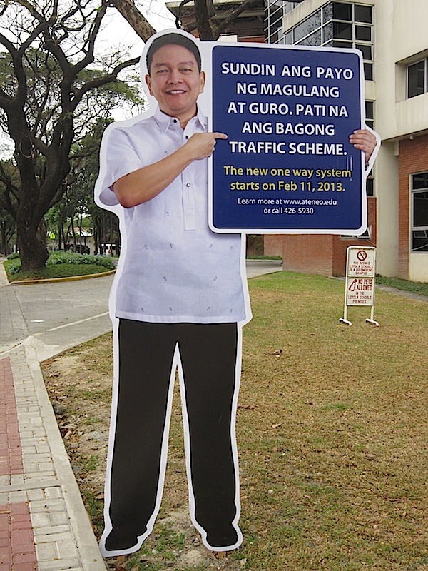 cut-out sign with Fr Jett Villarin SJ