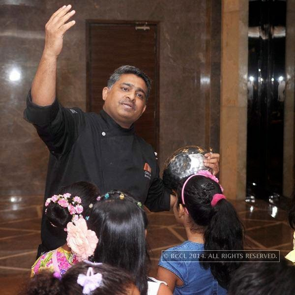Girish Krishnan , Executive Chef JW Marriott New Delhi Aerocity with the kids during the chocolate making session hosted Ritu Beri at the Delhi Baking Company, JW MArriott, Aerocity.