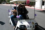 Blake caught a ride in the Hanna Montana-mobile....personally decorated by the driver....the best part was the pinwheel...one of these years Miranda will get a golf cart decorated in her honor