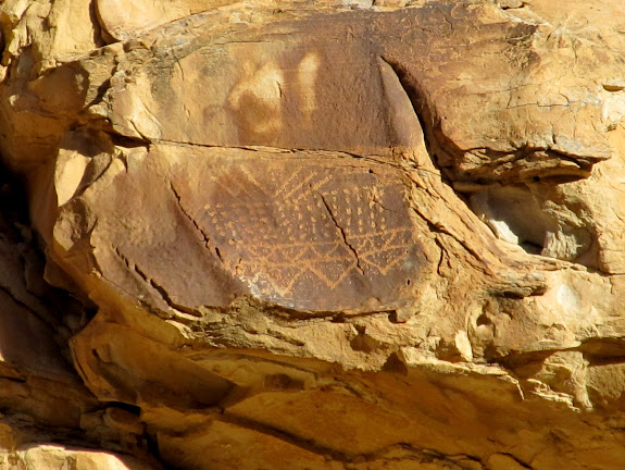 Petroglyphs high above the road