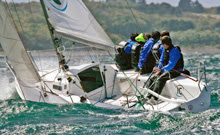 J/80 one-design sailboat sailing upwind off France