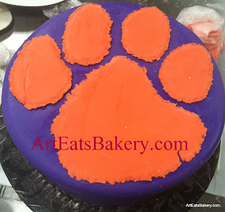 Purple and orange fondant Clemson tiger paw custom unique birthday cake picture