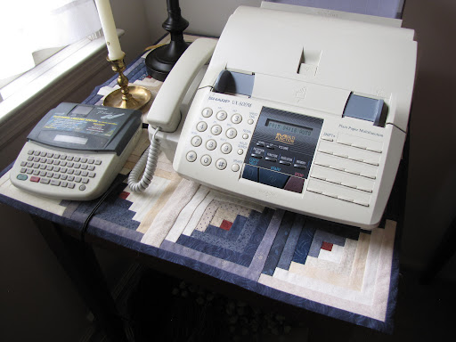 Even the fax machine (?) gets a quilt.
