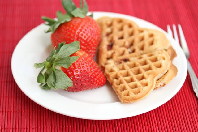 photo of Strawberry Cake Waffles on a plate with two strawberries