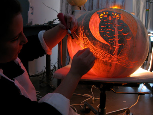 Here is Marcie, carving the owl on a giant white pumpkin.
