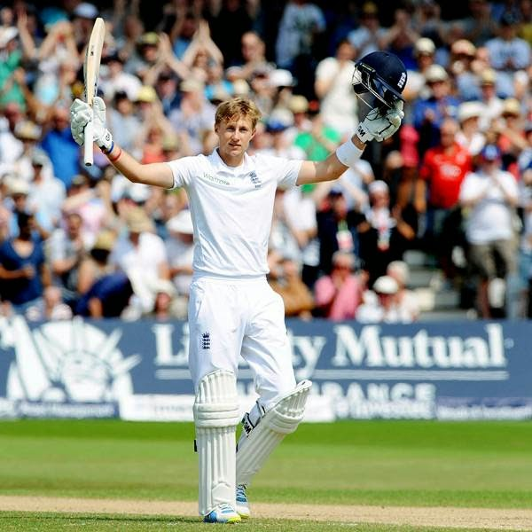 England's Joe Root celebrates after reaching a century during day four of the first test between England and India at Trent Bridge cricket ground in Nottingham, England, Saturday, July 12, 2014.