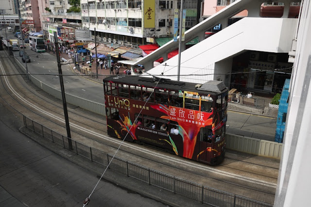 Tram in Hong Kong with UniQ Grand condos advertising